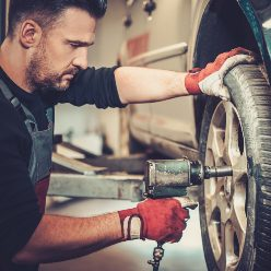 professional-car-mechanic-changing-car-wheel-in-au-P8FRMQ5.jpg